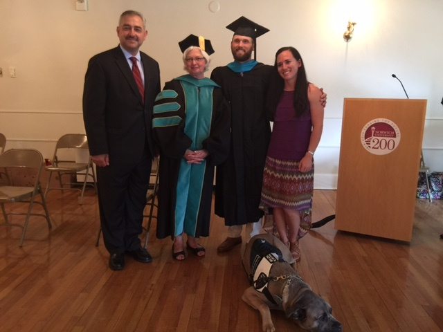 Ryan Lundbohm with his wife, Dr. Rosemarie A. Pelletier and Dean William Clements