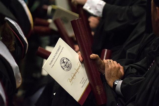 graduate-holding-norwich-commencement-program
